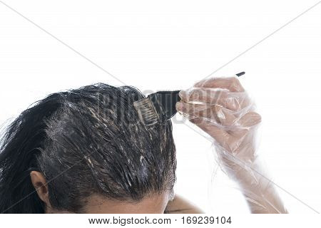 Woman dyeing her hair isolated on white