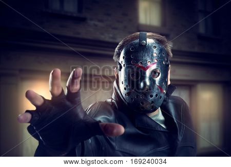 Serial murderer in hockey mask and leather gloves