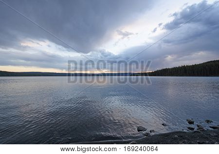 Rain Clouds at Sunset on Shoshone Lake in Yellowstone National Park in Wyoming