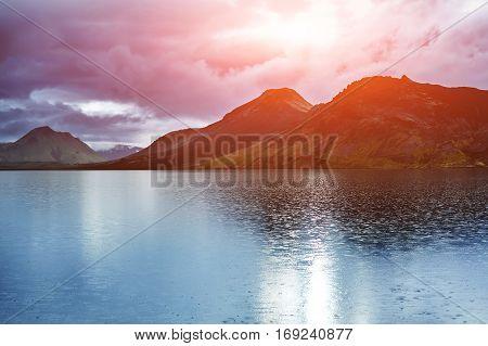 Lake coast with mountain reflection at the sunrise, Iceland. treking in Iceland. Travel concept.