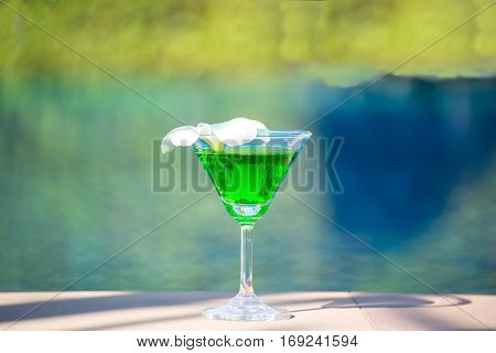 Tasty cocktail background swimming pool greenery tone