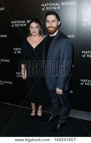 NEW YORK-JAN 4: Director Trey Edward Shults (R) and guest attend the National Board of Review Gala at Cipriani Wall Street in New York on January 4, 2017.