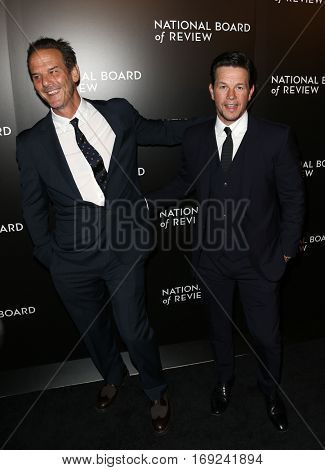 NEW YORK-JAN 4: Director Peter Berg (L) and Mark Wahlberg attend the National Board of Review Gala at Cipriani Wall Street in New York on January 4, 2017.