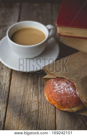 Relax time from book with Hot Coffee and Donut on wood Background used for food ad or website promote