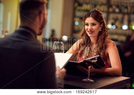 Girlfriend with boyfriend celebrate anniversary in restaurant