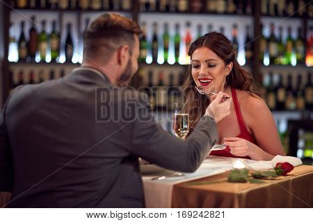 Handsome man and woman in love at dinner