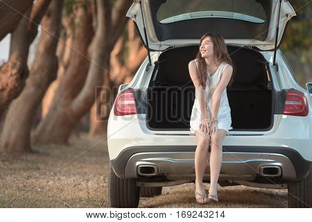 beautiful happy smiling teen girl  on car in the park during morning time holiday