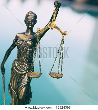 Scales of Justice - legal law concept image.  Intentional grunge cross processed look - edgy image angle for dynamic look.