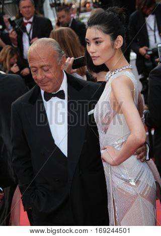 CANNES, FRANCE - MAY 18, 2016: Fawaz Gruosi & model Ming Xi at the gala premiere of
