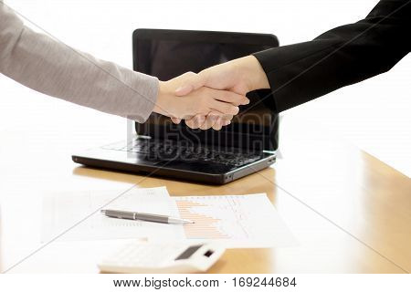 Two Business people shaking hands indoors, agreement