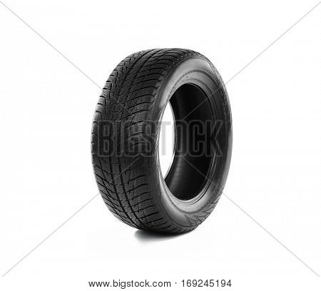 Rubber winter tire on white background