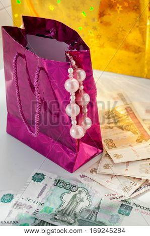 Package With Pink Pearls And Russian Banknotes