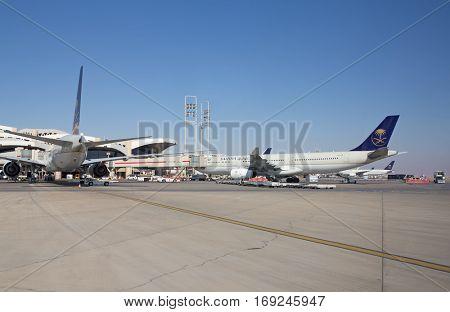 Riyadh - March 01:  Planes preparing for take off at Riyadh King Khalid Airport on March 01, 2016 in Riyadh, Saudi Arabia. Riyadh airport is home port for Saudi Arabian Airlines.