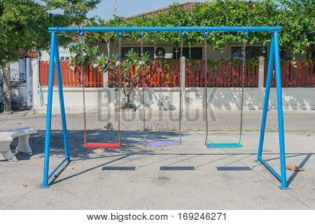 Empty chain swing in playground at public park.