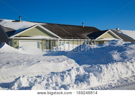 Homes in a North American suburb after a snow storm.