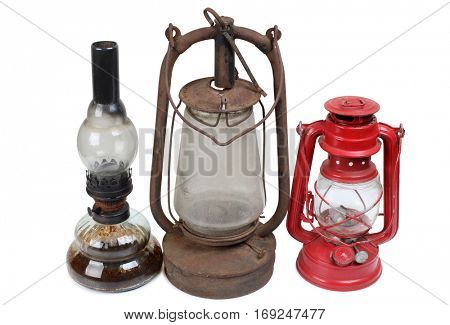Old kerosene lamps on white background