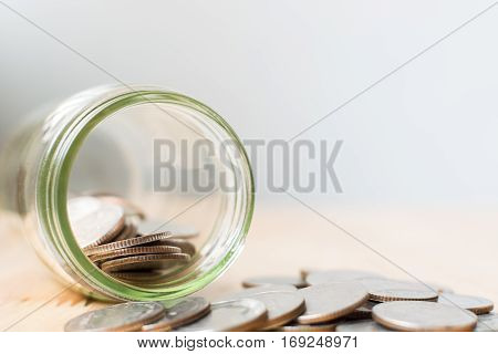 Concept saving money business finance for investment Coins in the glass