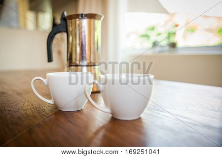White Cups And Coffee Plunger