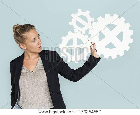 Businesswoman Holding Gear Symbol Connection Concept
