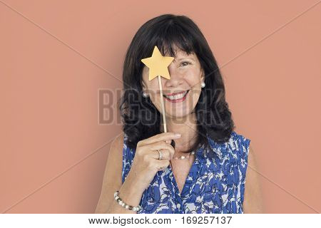 Caucasian Lady Holding Paper Crafted Star