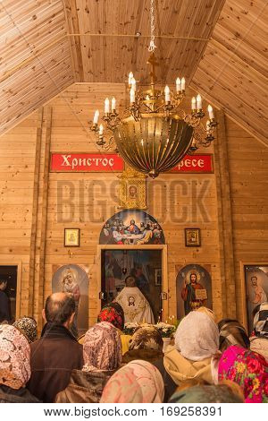 The Interior Of The Wooden Church With Parishioners. Dobrush, Belarus