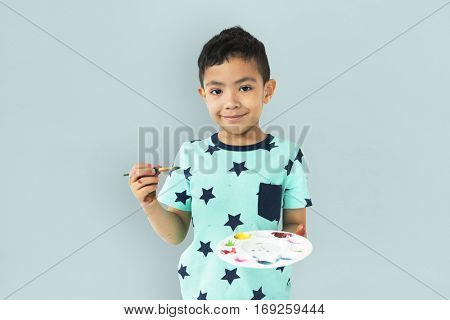 Little Boy Hands Hold Colors Plate Paint