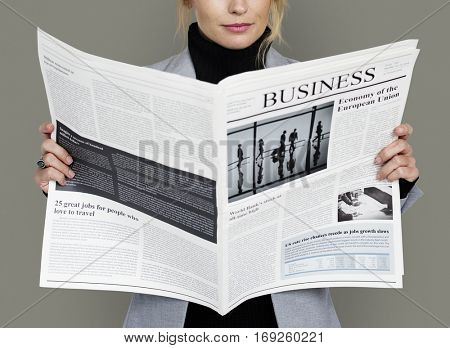 Business Woman Reading Newspaper Concept