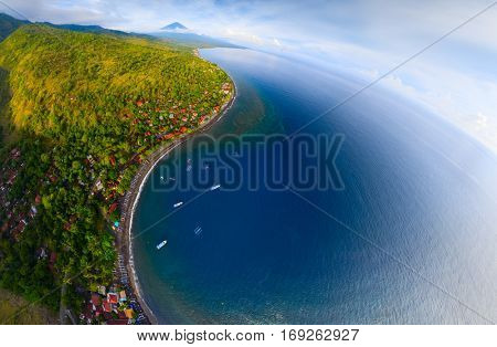 Aerial panorama of the north east coastline of the island of Bali, region of the village of Amed. Indonesia