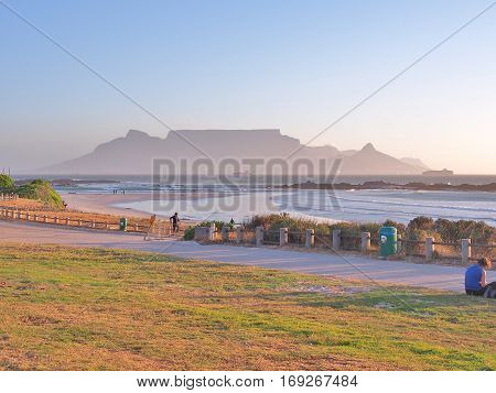 Cape Town, South Africa - November 11, 2016: View of Table Mountain and Cape Town seen from Big Bay Beach. Big Bay is located in Bloubergstrand on the West Coast of South Africa.