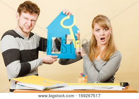 Young Marriage Arguing About First House Buying.
