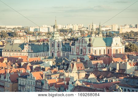 Poznan, Poland - August 30, 2016: Vintage Photo, View On Buildings And Collegiate Church In Polish T