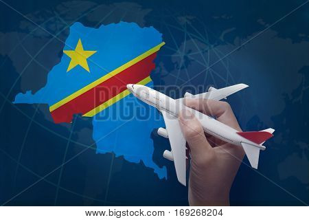 hand holding airplane with map of Democratic Republic of the Congo.