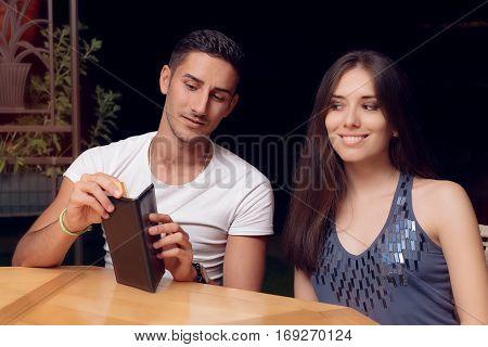 Boyfriend checking Restaurant Bill on a Date