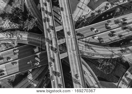 Black and white aerial view downtown four level interchange of the Harbor, Pasadena and Hollywood Freeways.
