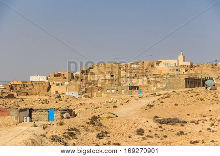 Berber village Tamezret at Gabes Governorate in the hot desert of Northern Africa in Tunisia