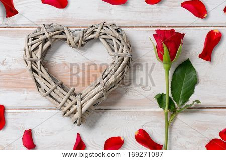 Rose And Wicker Heart Surrounded With Rose Petals