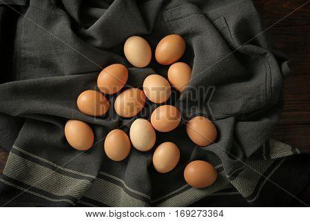 Raw eggs on tablecloth, closeup