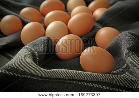 Raw eggs on tablecloth, closeup