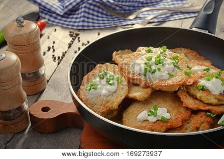 Composition with tasty potato pancakes for Hanukkah on wooden table, closeup