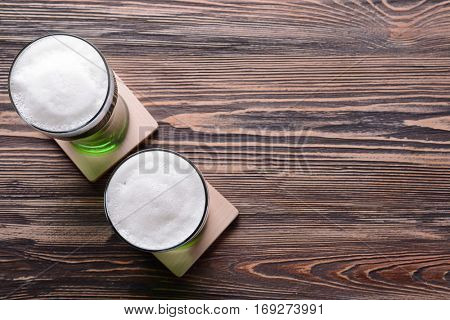 St. Patrick Day concept. Glasses of green beer on wooden background, closeup