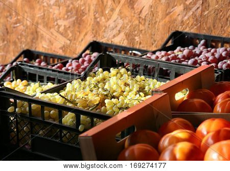 Fresh fruits in boxes on market