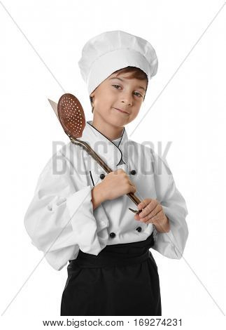 Cute boy in chef uniform on white background