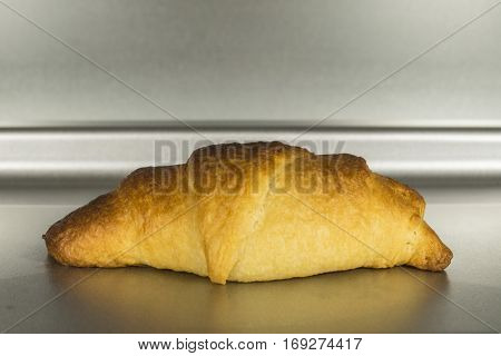 Fresh baked croissant in clean oven.