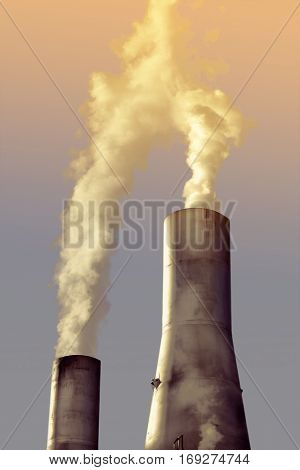 Factory chimney pipe with smoke. Pollution concept.