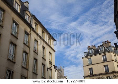 Ancient stone building in Paris, France with a blue sky
