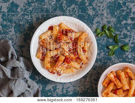Rigatoni with tomato sauce. Delicious mediterranean lunch top view