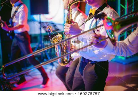 Musician Plays The Saxophone Performance At A Concert