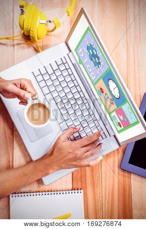 Bubble blog and pictures against womans hands typing on a laptop