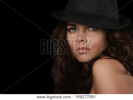 Beautiful Young woman On Black with Hipster Hat