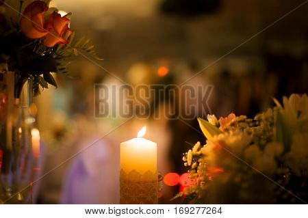 Kindled Flame Of A Candle On A Blurred Background